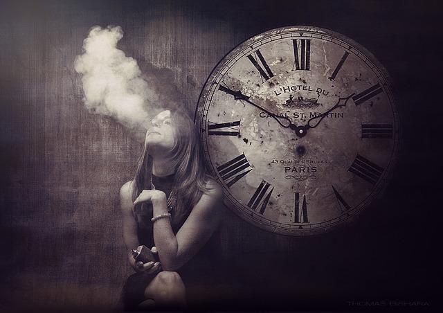 Vaper beside clock